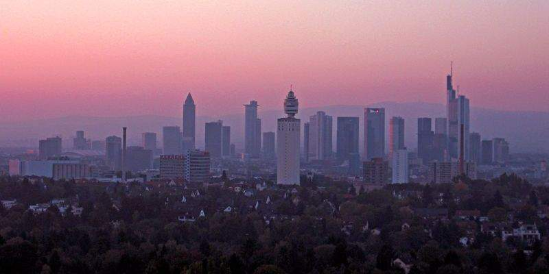Skyline of a big city in the purple sunset